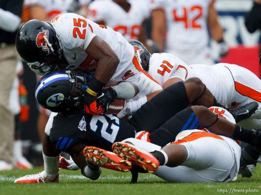Trent Nelson | The Salt Lake Tribune BYU's Jamaal Williams is brought down by Oregon State's Ryan Murphy (25) and Feti Taumoepeau (41) as BYU hosts Oregon State college football Saturday October 13, 2012 in Provo, Utah.